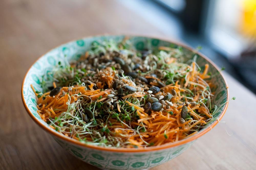 red clover used a spart of a healthy carrot and seed salad